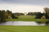 View across the Octagon Lake towards the Lake Pavilions and Corinthian Arch at Stowe Landscape Gardens, Buckinghamshire.